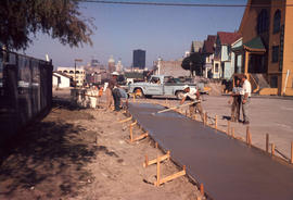 Pouring new sidewalk in the 500 block Pender [Street]