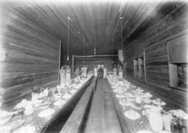 C.N.P. Lbr. [Crow's Nest Pass Lumber] Co. dining room [with kitchen staff and set tables]