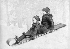 [Percy and Arthur Onderdonk on a sled]