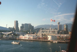 [Expo 86, Canada flag and view looking toward downtown Vancouver across False Creek]