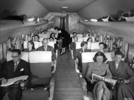 "Passengers aboard the Canadian Pacific [Airlines] ""Empress of Vancouver""."