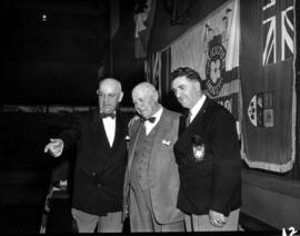 G.S. Powell and A.M. James with unidentified guest at unveiling ceremony for Challenger relief ma...