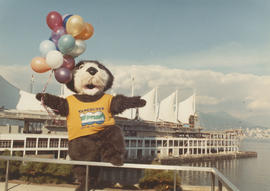 Tillicum posing with balloons in front of Canada Place