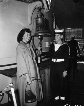Miss P.N.E. contestant ringing bell with sailor aboard the H.M.S. Sheffield
