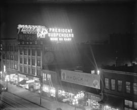 [Illuminated sign for President Suspenders, located on top of commercial building on Hastings Str...