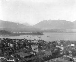 [View of West End buildings, Burrard Inlet, part of Stanley Park, and North Shore mountains from ...