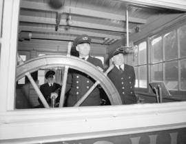 "Ship's officers [at the wheel on the] ""Tutshi"""