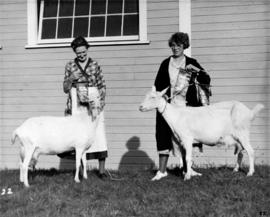 Women with prize-winning goats