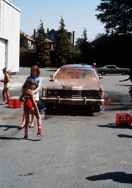 Children with painted car [paint splashed on car]