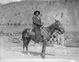 [Unidentified man on a horse]