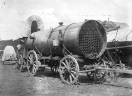 [Machinery for La Fontine towed by a covered wagon on the Cariboo Road]