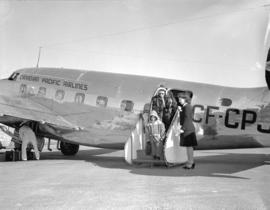 Canadian Pacific Airlines [passengers disembarking]