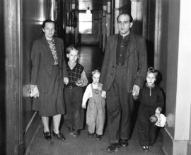 [Hungarian refugees in the Immigration Building at the airport]