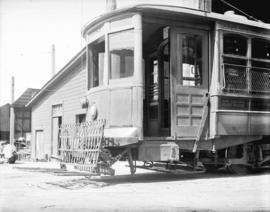 [Front end of streetcar number 815, showing safety fender]