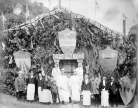 [Cooks, servers and others for the luncheon of the official opening of the bridge in front of a d...