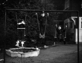 [Children playing on playground equipment at the Preparatory School for Little Children]
