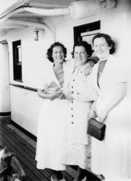 Three women on boat [Bowen Island ferry?] on way to employee picnic, including Elsie Thornton