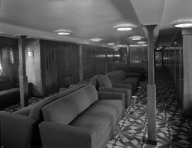[Interior view of a seating area on board a Union Steamships vessel]