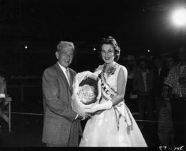 Carol Lucas, Miss P.N.E., presenting prize of turkey at 1957 P.N.E. Poultry competition