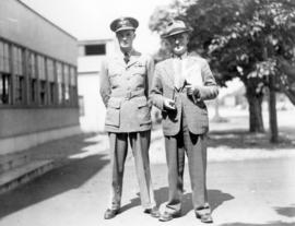 [Mr. H.V. Collins and his son in uniform]