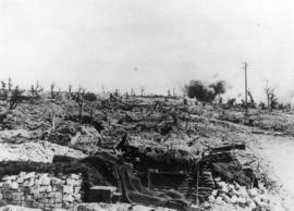 Shells bursting in a village on the Canadian front
