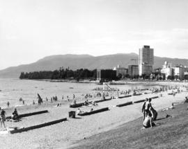 View of English Bay beach, looking west toward Stanley Park, showing Englesea Lodge