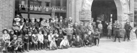 [The Daily Province delivery boys in front of the building at 420 Cambie Street]