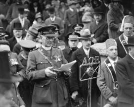 "Armistice Day ceremonies at Cenotaph [N.B. ""A.C.R."" on microphone stands for Austin Cha..."