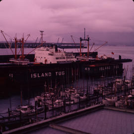Berths beside refinery dock, tug