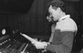 Two men behind mixing boards at Griffiths Gibson Productions