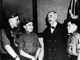 "E.H. ""Gramps"" Milne at ""Good Citizen, Vancouver"" award ceremony with Boy Scouts"