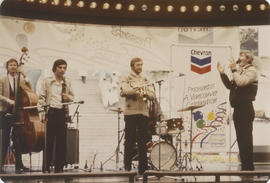 Band on Chevron stage at a Centennial event