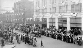 [Georgia Street looking west during a parade showing the old and new Hudson Bay Stores decorated ...