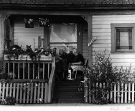 Two elderly residents on the porch of 1855 Powell Street
