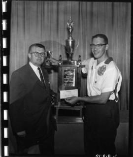 P.N.E. 5-Pin Bowling Championship champion and man with Coca-Cola trophy