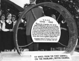 [A fly-wheel from the Land and Fleming Sawmill used as a monument to commemorate the centennial o...