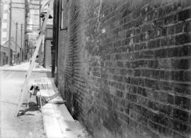 [Damaged brickwork on wall at Granville Lane and Smithe St.]
