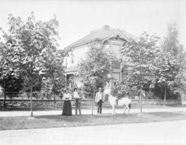 [Mrs. C.N. Davidson and others on the boulevard in front of her house at 731 Burrard Street]