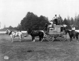 Four-horse team with a stagecoach and outriders