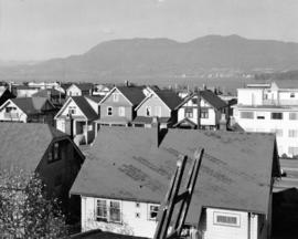 [View looking north showing houses and an apartment building in the 2100 block 5th Ave West]