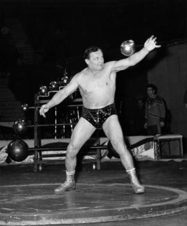 Strongman with steel ball in Moscow Circus performance