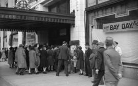 [Crowds entering Hudson's Bay Co. store for 'Bay Day' sale]