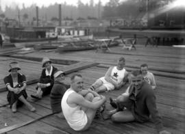 Vancouver Rowing Club Regatta, Coal Harbour [group relaxing on dock]