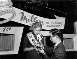 Miss P.N.E., Glenda Sjoberg, at Millers Jewelers display in Manufacturers building