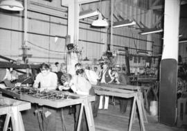 [Workers assembling airplane parts at the Boeing plant on Sea Island]