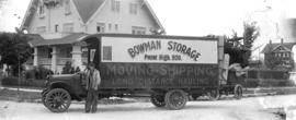 [Bowman Storage moving truck and driver in front of house at the corner of Hudson and Laurier Ave...
