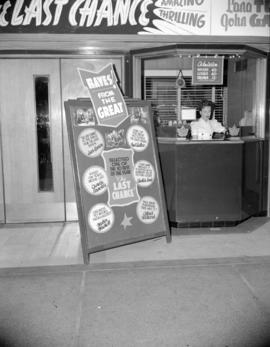 "[Strand Theatre box office showing advertising for ""The Last Chance""]"