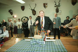 Man in kilt before the cutting of the haggis