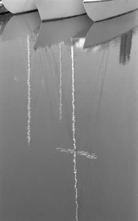 Reflection of 3 masts in the water