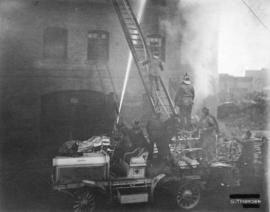Firefighters and equipment in action at G.H. Cottrell Warehouse, 139 Water Street